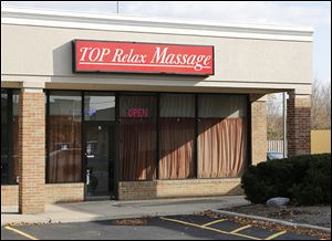 According to an FBI affidavit, a worker was alleged to have offered to perform a sex act at Top Relax Massage at 1855 S. Reynolds Rd.