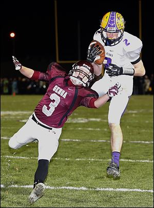 Bryan's Sean Culler makes a catch against Genoa's Andrew Belcik in Friday night's playoff game.