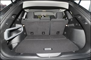 The back seats split 60-40 and fold down flat. The Cherokee doesn't have as much cargo space as the Honda CR-V and Toyota RAV4. The back seat sits three, but not very far if comfort is desired.