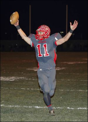 Bedford's Alec Hullibarger celebrates a touchdown in the fourth quarter. He scored four touchdowns on the night.