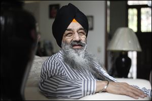 Kuldeep Singh,  pictured at his home, is a board member of the Council for a Parliament of the World's Religions.