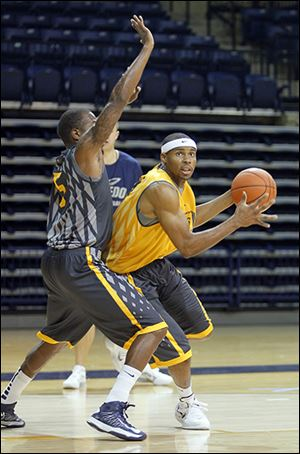 Toledo's J.D. Weatherspoon, right, has played his way into a starting forward position for the Rockets this season.