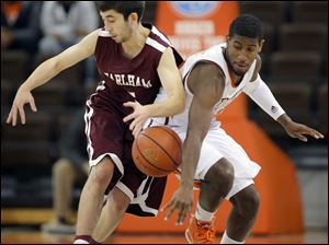 Bowling Green State University guard Jehvon Clarke (20) steals the ball from Earlham Jack O' Flaherty (5).