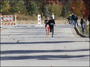 Marco Capelli, of Perrysburg, front, and Jonathan Hoag, of Whitehouse, are close to each other 100 yards from the finish line. Capelli would finish first.