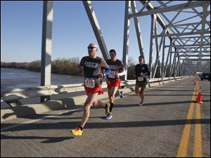The front runners on the SR 64 bridge in Waterville. From left: Jonathan Hoag, of Whitehouse, Kevin Egan, of Toledo, and Ryan Pyle, also of Toledo.