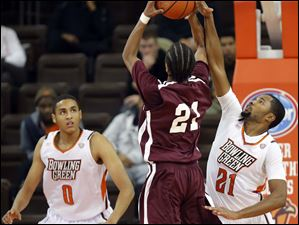 Bowling Green State University guard Chauncey Orr (21) defends against Earlham forward Phillip Boone (21).