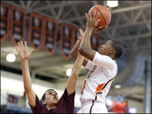 Bowling Green State University guard Anthony Henderson (2) takes a shot against Earlham guard Michael Parker (33).