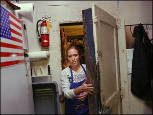 Lindsey Batdorf exits the meat locker.