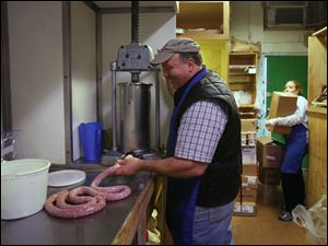 Steve De Land makes specially blended Polish style sausage.