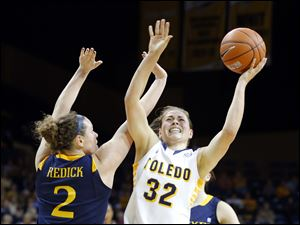 University of Toledo player Ana Capotosto (32) battles for a rebound with Drexel University player Abby Redick during the first half.