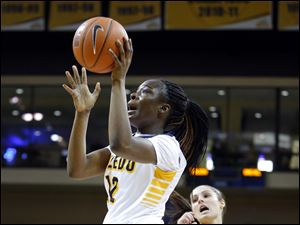 Toledo player Janice Monakana (12) gets past Drexel University player Rachel Pearson (24) during the first half.