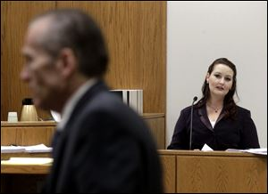 Gypsy Willis, who had an affair with Martin MacNeill, looks towards MacNeill from the witness stand during a recess in his murder trial Thursday in 4th District Court in Provo, Utah.