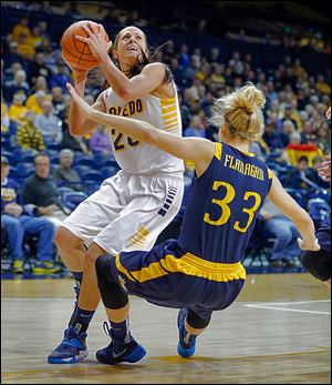Toledo's Stephanie Recker, left, runs into Drexel's Fiona Flanagan during the first half of their Glass City Tournament contest.