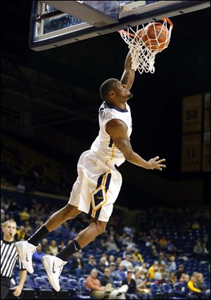 UT's Rian Pearson dunks against Northwestern Ohio in Saturday night's season opener at Savage Arena. Pearson scored a team-high 19 points as six Rockets scored in double figures.