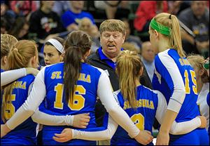 St. Ursula coach John Buck  gives instructions to his players during Saturday's state final.