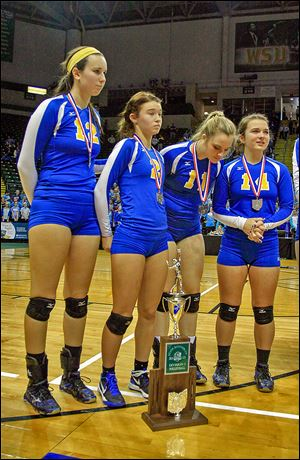 Lauren Daudelin, left, Madelyn McCabe, Hannah Engler, and Connie Baumgartner wait as St. Ursula is awarded the Division I state runner-up trophy.