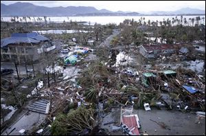 Tacloban Airport is covered by debris after powerful Typhoon Haiyan hit Tacloban city, in Leyte province today in central Philippines.