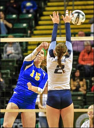 St. Ursula's Elizabeth Coil has her shot blocked by Cincinnati Mount Notre Dame's Mari Lingardo in Saturday's Division I state final at Wright State's Nutter Center. The Arrows finish the season 29-1.