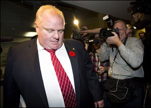 City of Toronto Mayor Rob Ford leaves his office for the day Friday in Toronto.
