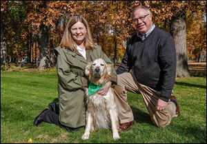 Sandy Drabik and D. Michael Collins pose with their dog Chloe at their South Toledo home. Ms. Drabik plans to support and counsel the mayor-elect as well as concentrate on his push for a concept called 'Tidy Towns.'