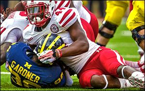 Nebraska defensive end Randy Gregory sacks Michigan's Devin Gardner in the first quarter. The Wolverines had minus-21 yards rushing Saturday and are minus-69 rushing the past two games.