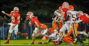 Eastwood's Grant Geiser tries to break a tackle in Saturday night's playoff game against Coldwater.