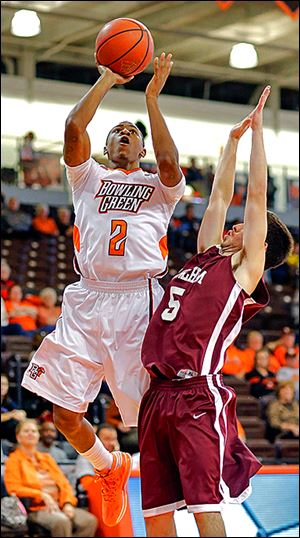 BG's Anthony Henderson shoots over Earlham's Jack O'Flaherty. Henderson scored 15 points.