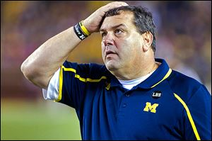 UM coach Brady Hoke glances at the scoreboard. He lost for the first time at Michigan Stadium.