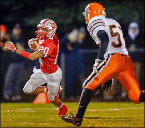 Eastwood's Devin Snowden runs the ball against Coldwater in a Division V playoff game Saturday,