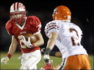 Eastwood's Brent Schlumbohm (24) runs the ball against Coldwater.