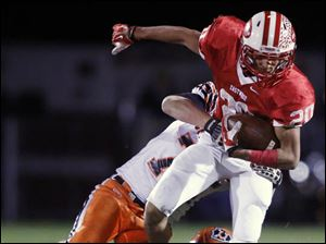 Eastwood's Devin Snowden (20) runs the ball against Coldwater.