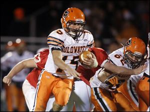 Coldwater QB Brody Hoying (15) runs the ball against Eastwood.