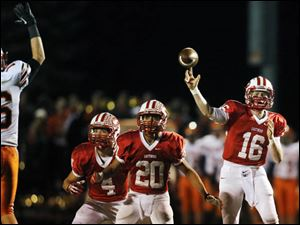 Eastwood QB Jake Schmeltz (16) throws the ball against Coldwater.