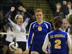 Mount Notre Dame's Jessica Towle, 15, celebrates another point as St. Ursula's Lauran Graves, 8, walks back to talk to Madelyn McCabe, 2.