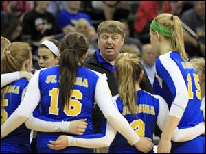 St. Ursula head coach John Buck  talks to his players during a timeout.