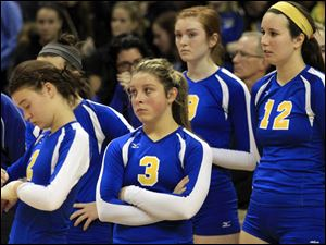 St. Ursula players react after the end of the match, their first and only loss of the season.