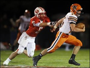 Coldwater QB Brody Hoying (15) runs past Eastwood LB Ryan Mang to score a touchdown.