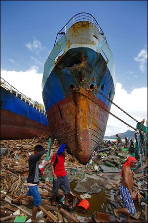 A ship is washed ashore in Tacloban by strong waves caused by the typhoon.