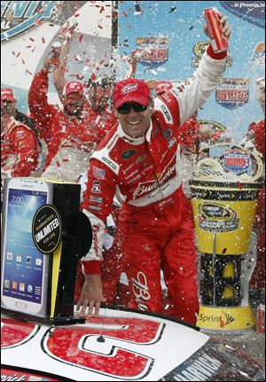 Kevin Harvick celebrates in victory lane after winning the AdvoCare 500 NASCAR Sprint Cup Series race Sunday at Phoenix International Raceway in Avondale, Ariz.