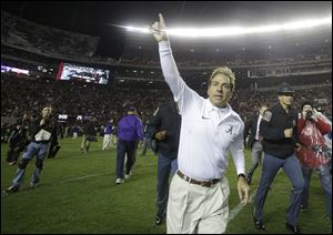 Alabama head coach Nick Saban runs off the field after the second half of an NCAA college football game against LSU on Saturday in Tuscaloosa, Ala.