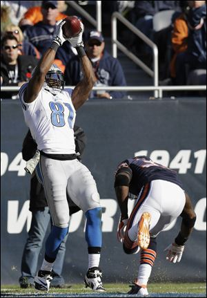 Detroit Lions wide receiver Calvin Johnson makes a touchdown catch on Sunday, part of a  Johnson had six-reception, 83-yard game.