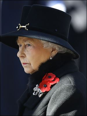 Britain's Queen Elizabeth II listens during the service of remembrance today at the Cenotaph in Whitehall, London.