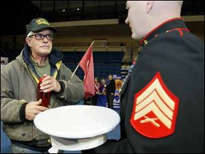 U.S. Marine Corps veteran Thomas C. Smith, left, speaking with U.S.M.C. Sgt. Patrick Sawyer, both of Toledo. November 10th, 2013 was the 238th birthday of the Corps.