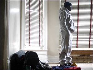 Shawn Mahone, Sr., executive director of Young Men and Women for Change, stands in a vacant home at 727 Oakwood Ave. where he will stay during his 72 hours of homelessness.