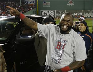 Boston Red Sox designated hitter David Ortiz laughs after being named the MVP after Game 6 of baseball's World Series, in Boston, on Oct. 31.