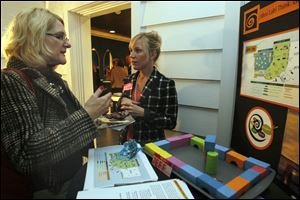 Cathy Sheets, left, speaks with Sloan Mann, assistant director of S.T.E.M. education for the Imagination Station, about the Idea Lab. It is to be an interactive exhibit with space for a workshop.