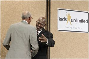Toledo Mayor Mike Bell greets Detroit Mayor Dave Bing during the Kids Unlimited State of the Child banquet Monday at the Pinnacle in Maumee.