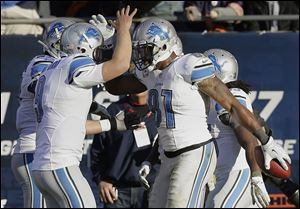 Detroit receiver Calvin Johnson, right, celebrates his touchdown reception with quarterback Matthew Stafford during the second half against the Bears. The Lions won to improve to 6-3.