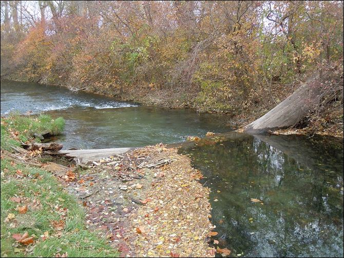 s3millsite-4 This section of Cold Creek runs through the Millsite Trout & Gun Club property, located near Castalia and Sandusky, just downstream from the Ohio Division of Wildlife fish hatchery. The Millsite property will be sold at auction on Nov. 21.