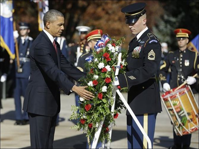 Obama Veterans Day WREATH President Obama places a wreath at the Tomb of the Unknowns at Arlington National Cemetery in Arlington, Va., today.